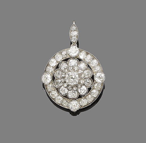 A late 19th century diamond cluster pendant/brooch,