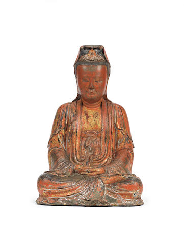 A large lacquer and painted bronze figure of Guanyin 16th century