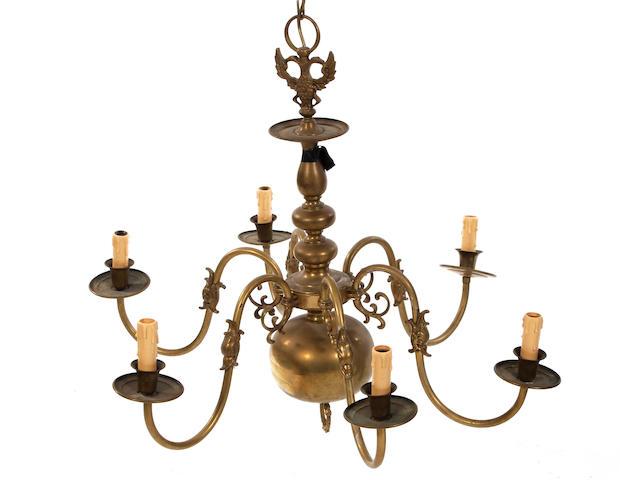 A Dutch-style brass six-branch chandelier