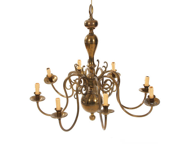 A 19th century Dutch-style eight-branch brass chandelier