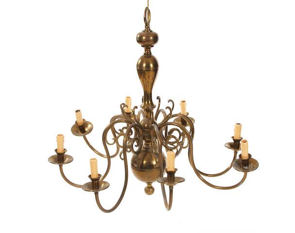 A 19th century Dutch-style eight-branch brass chandelier