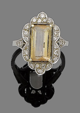 A topaz and diamond dress ring