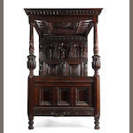 An Elizabethan Revival oak tester bed