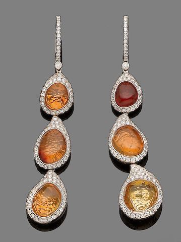 A pair of fire opal and diamond pendent earrings