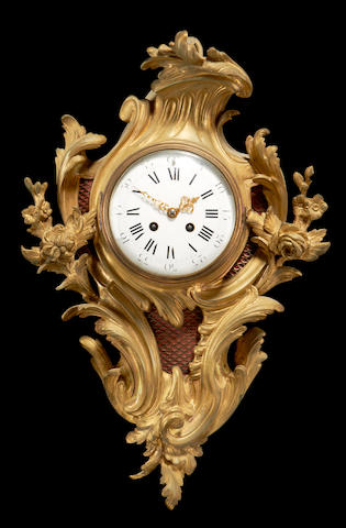 A late 19th century gilt metal cartel clock in the Rococo style