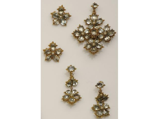 A 19th century aquamarine and half pearl pendant, brooch and earpendants suite