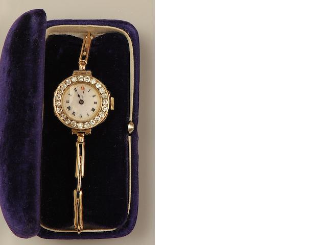 An early 20th century lady's diamond set wristwatch