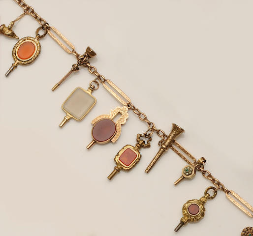 An Albert chain, with a collection of hardstone set fob pendants and watch keys