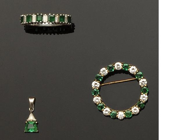 A diamond and emerald brooch (3)
