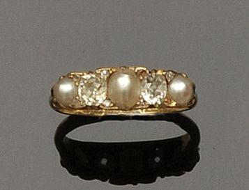 An 18ct gold half pearl and diamond five stone ring
