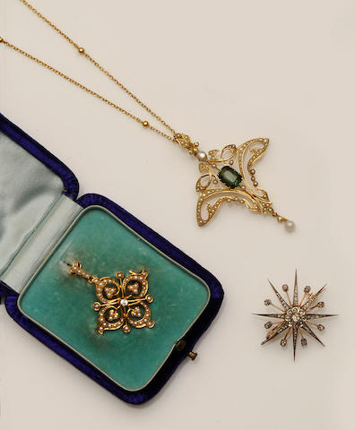 Two late Victorian pendants and a diamond star brooch (3)