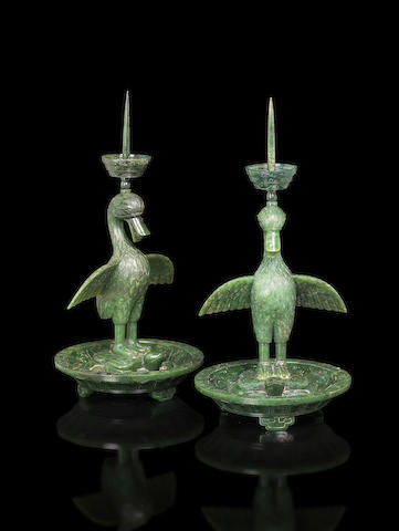 A rare pair of spinach-green jade 'duck and tortoise' candlesticks Qianlong/ Jiaqing