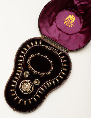 An Archaeological Revival necklace, bangle and brooch suite, in the manner of Castellani, circa 1870