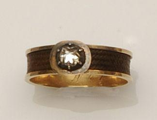 An early 19th century diamond set memorial ring,