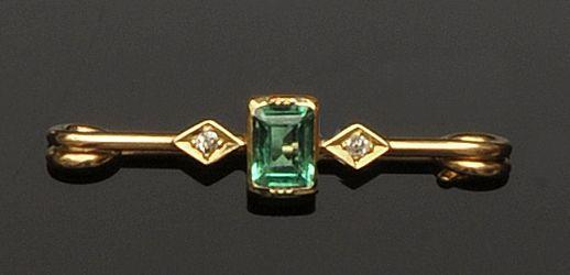 An emerald and diamond three stone bar brooch