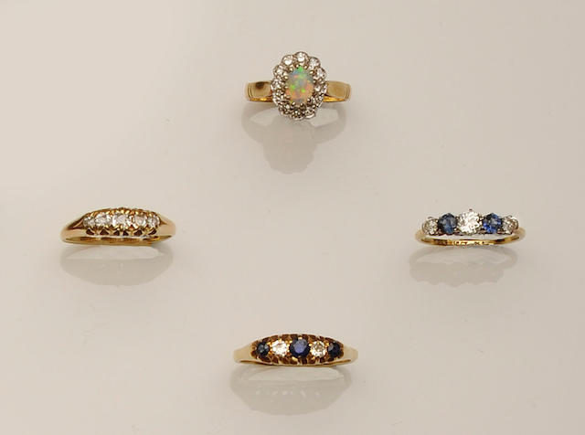 A collection of diamond set rings (4)