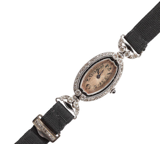 An early 20th century lady's diamond and onyx wristwatch
