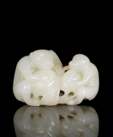 A white jade group of two monkeys and peaches 18th century