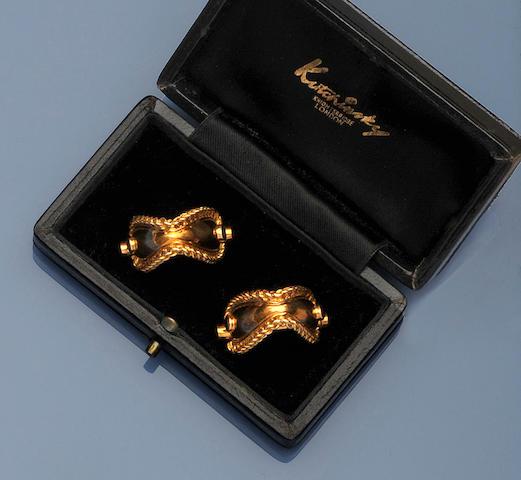 Kutchinsky: A pair of 18ct gold sapphire set cufflinks