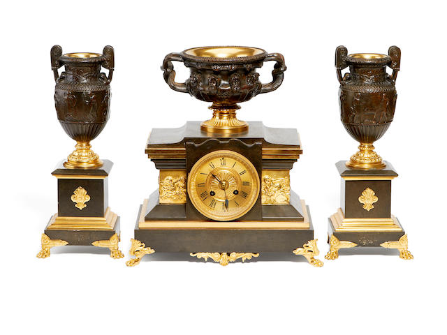 A late 19th century French bronze and parcel gilt clock garniture