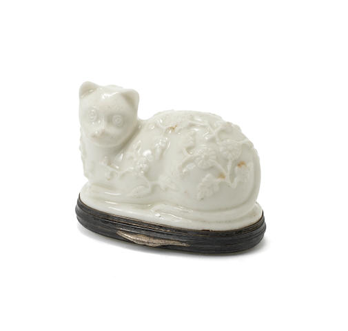 A Mennecy silver-mounted snuff box in the shape of a recumbent cat, circa 1745