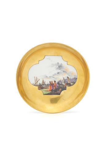 A Meissen saucer with Kauffahrteiscenes against a gold ground