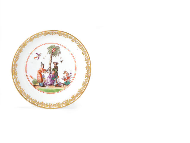 A Meissen saucer with chinoiserie scenes and moulded stiff leaves to the back