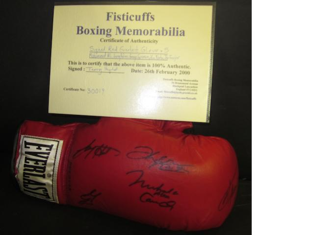 A boxing glove signed by 5 former heavyweight world champions