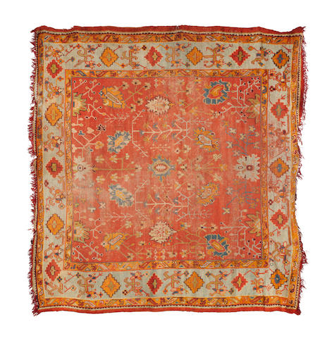 An Ushak carpet, West Anatolia, circa 1890, 10 ft x 10 ft 4 in (303 x 314 cm)losses at each end, wear