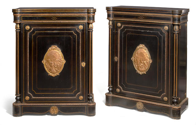 A pair of Victorian gilt metal mounted and brass line inlaid ebony and ebonised hauteurs d'appui