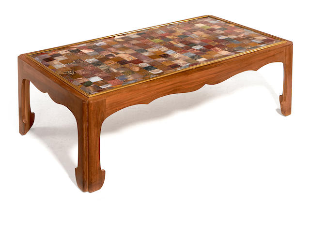 A specimen marble and walnut framed coffee table