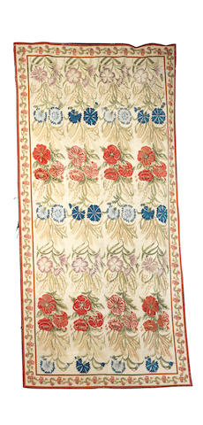 A 19th century English needlepoint carpet, circa 1880, 13 ft 5 in x 6 ft 7 in (409 x 201 cm) possibly reduced in size, moth damage