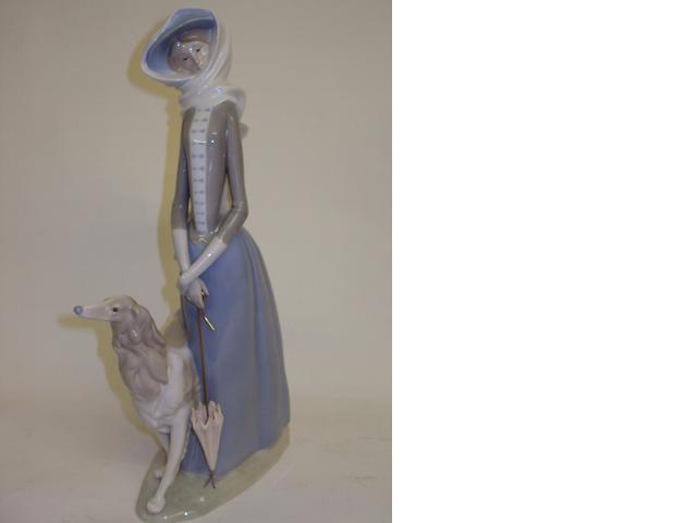 A Lladro figure of a lady and dog