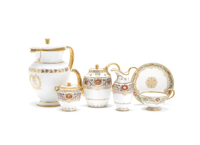 Sevres part set from the Hunting Servce of Louis philippe, coffee pot and cover, sucrier and cover, jug and one cup and saucer, (with gilder's marks), and a Louis Phillipe Ivy Service wine jug and cover