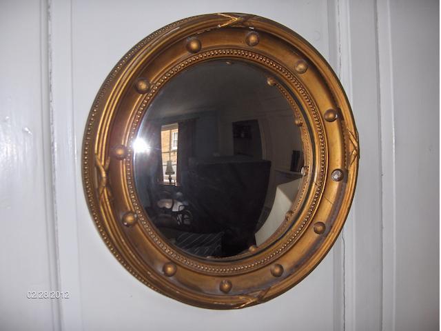 A Victorian giltwood and gesso circular convex wall mirror