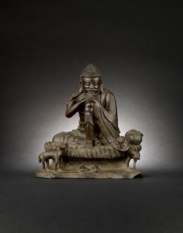 A bronze figure of a seated Buddhist deity, possibly Sakyamuni Qing Dynasty