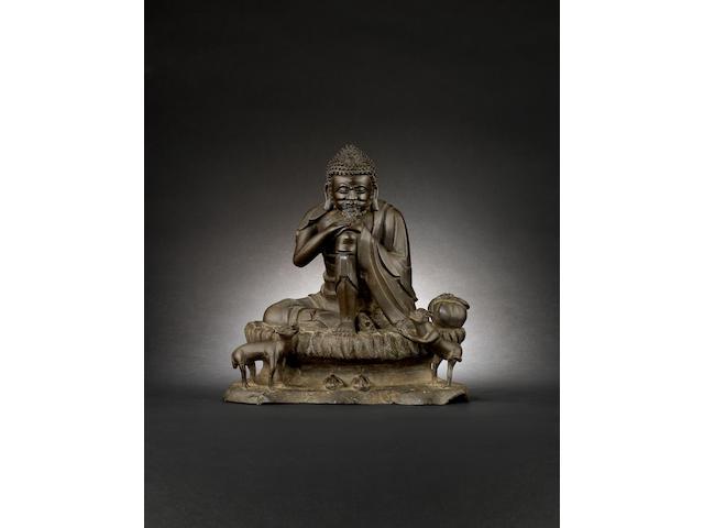 A bronze figure of a seated Buddhist deity, possibly Sakyamuni Qing Dynasty