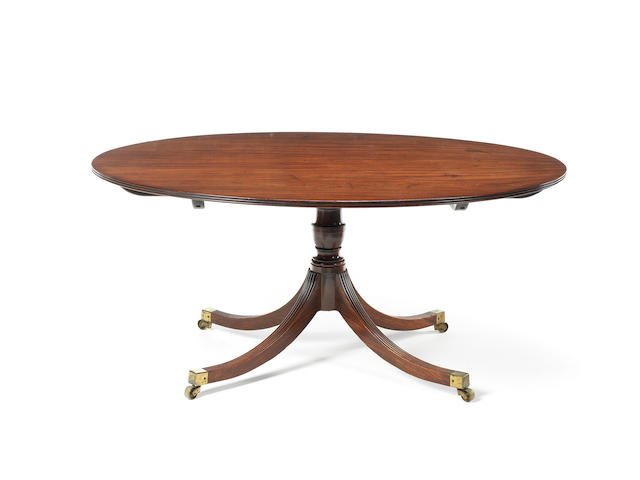 A large late George III mahogany oval breakfast table