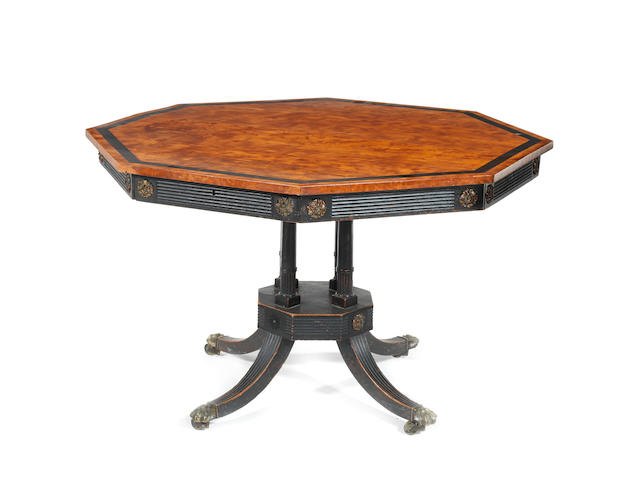 A Regency satinwood and ebonised drum top table
