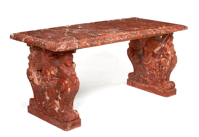 An impressive carved Rouge Royale marble centre table in the Baroque style