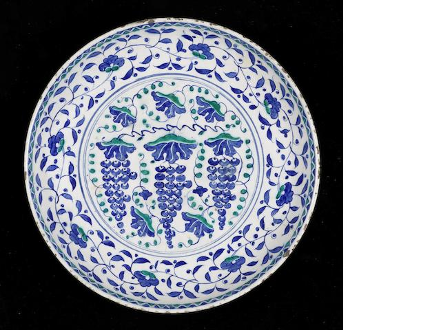 A large Iznik pottery rimless grape Dish Turkey, circa 1570
