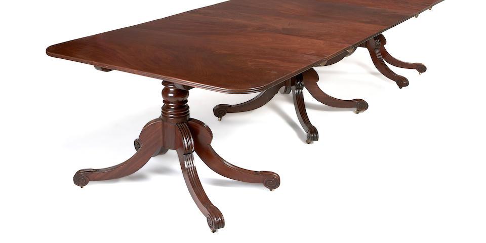 A Regency mahogany triple pedestal dining table