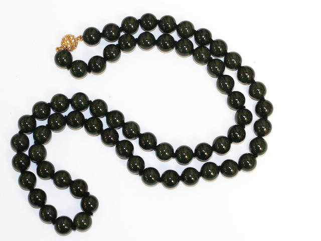 A dark green jade bead necklace (untested for treatments)