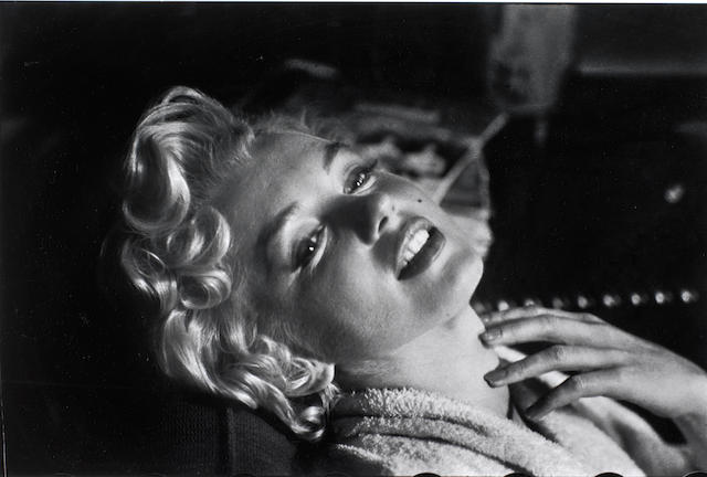Elliott Erwitt (American, born 1928) Marilyn, New York City, 1956 Paper 40.5 x 50.5cm (15 15/16 x 19 7/8in), image 29.9 x 44.8cm (11 3/4 x 17 5/8in).