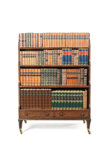 A Regency?? mahogany double-sided waterfall bookcase