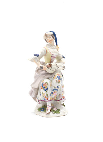 A Meissen figure of a female hurdy-gurdy player, circa 1745