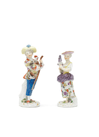 A pair of Meissen figures, a girl with a hen, a boy with a cockerel
