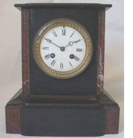 A 19th Century polished slate and marble inlaid mantle clock, 25cm.