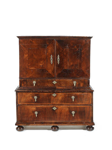 A William and Mary walnut crossbanded and featherbanded cabinet on chest
