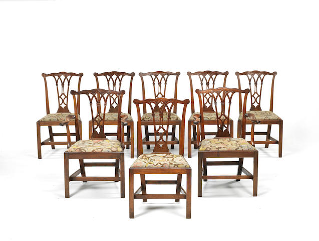 A set of eight George III carved mahogany dining chairsIn the Chippendale Gothic taste